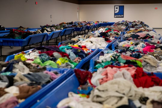 Bins of clothing and goods on sale by the pound at the new Goodwill Clearance Store located at 4135 Ayers Street.