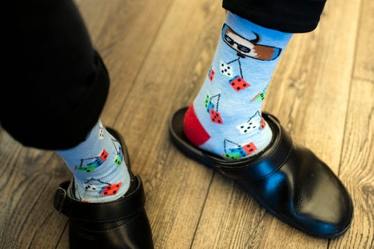 Hearthside chef de cuisine Dylan Sambalino sports some bold socks.