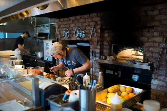 Chef and owner Dominic Piperno works on a dish inside Hearthside in Collingswood, N.J.