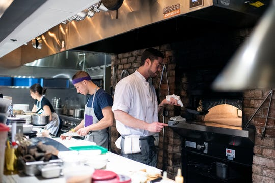 Chef de cuisine Dylan Sambalino works in the kitchen at Hearthside in Collingswood.