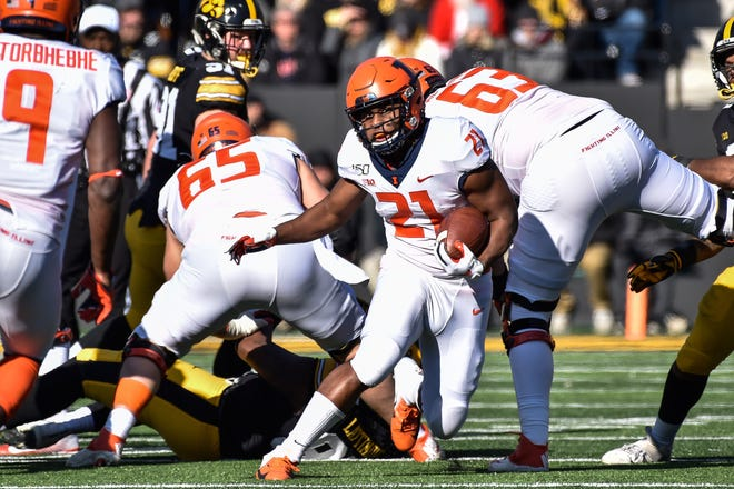 Nov 23, 2019; Iowa City, IA, USA; Illinois Fighting Illini running back Ra'Von Bonner (21) runs the ball against the Iowa Hawkeyes during the second quarter at Kinnick Stadium.