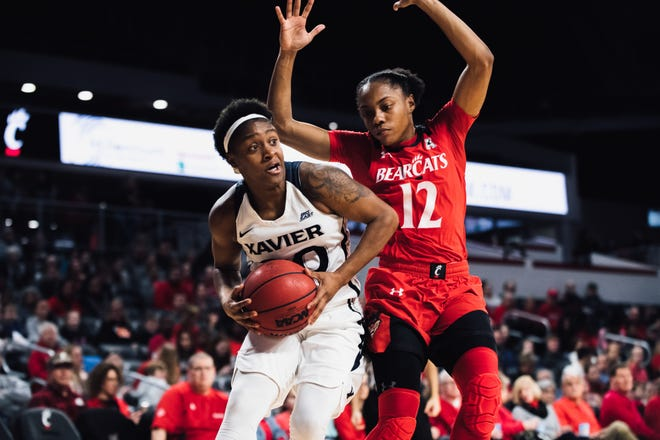 Xavier's Na'Teshia Owens goes up for a shot against Cincinnati's Antoinette Miller in the 2018 Crosstown Shootout at UC.