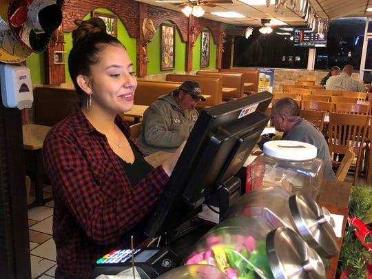 Manager Patricia Correa places an order at Los Hermanos Mexican Grill, 1302 Fort Campbell Blvd., on Dec. 5, 2019.
