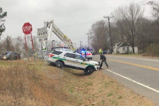 A Montgomery County Sheriff's Office patrol vehicle is crashed in a ditch on Bearwallow Road in Cheatham County after it was stolen and then chased on Monday, Dec. 9, 2019. It was stopped by spike strips.