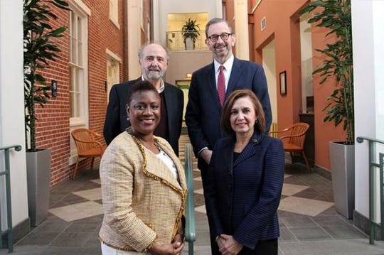 Nelida Valentin, vice president of Grants and Programs for the Princeton Area Community Foundation (front, right) joins TESU staff Barbara George Johnson, executive director, The John S. Watson Institute for Public Policy (front. left); Frederick S. Brand, director of Corporate and Foundation Relations (back, left); and John Thurber, vice president for Public Affairs.