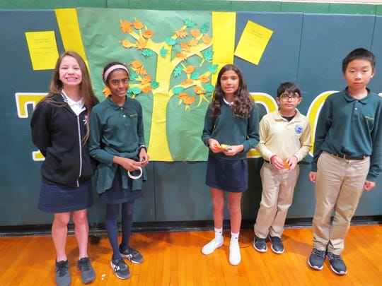 Middle School students gather by the Tree of Thanks. Pictured (from left): Phoebe Kaplan of Scotch Plains, Jini Looney of Metuchen, Kaya Singh of Piscataway, Pratham Gandhi of Edison and Jason Cheng of Clark.