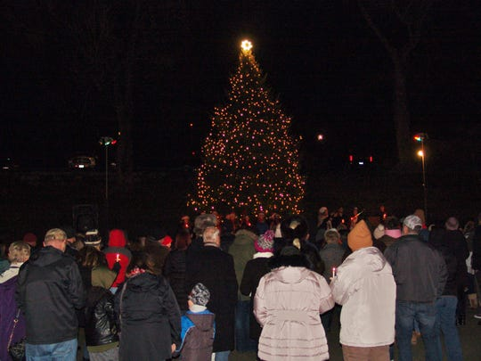 Roscoe Village visitors stand around the Main Stage as the Christmas tree is lit during the recently Christmas Candlelighting ceremony on Saturday. The next candlelighting ceremony will take place on Saturday.