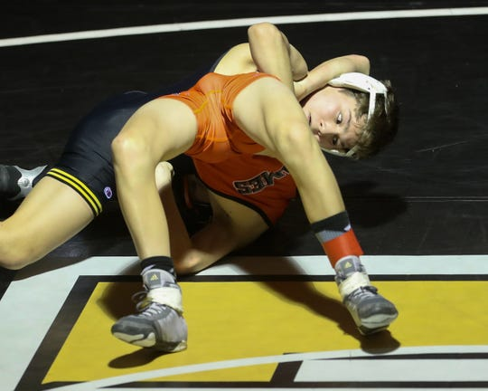Southeast Polk's Nathanael Jesuroga pins Ames' Kale Kline in a 106-pound match Dec. 5 at Southeast Polk High School. Jesuroga won by fall in 58 seconds. The Rams beat the Little Cyclones 72 - 10 to start the season.