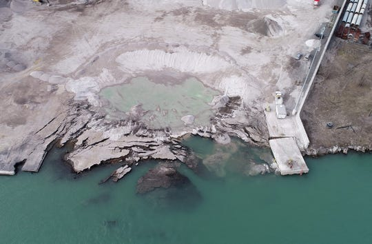 An aerial view, as seen on Saturday, December 7, 2019, of the Detroit property located next to Historic Fort Wayne where on November 26th 2019, the ground here contaminated with uranium and other dangerous chemicals partially collapsed into the Detroit River.The site known as the Detroit Dock allegedly collapsed under the weight of large aggregate piles that were stored at the site during Thanksgiving weekend. Aerial photography by Junfu Han/Eric Seals of the Detroit Free Press