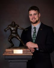 Michigan State defensive end Kenny Willekes poses with the Burlsworth Trophy on Monday, Dec. 9, 2019.