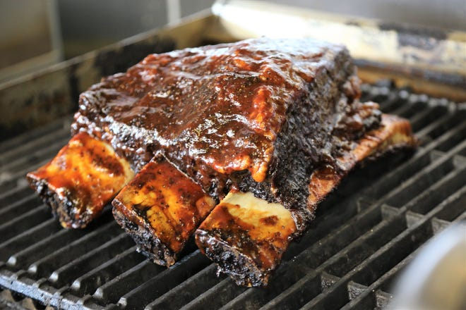 Smoked short ribs resting on the grill before slicing at A.B.'s Amazing Ribs in Dearborn Heights.