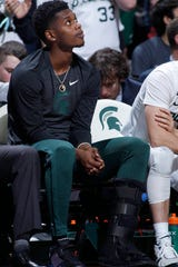 Michigan State's Rocket Watts watches from the bench against Rutgers, Sunday, Dec. 8, 2019, in East Lansing.