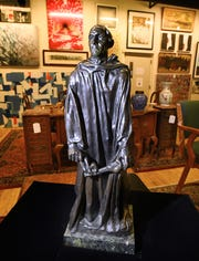 "Rodin's ""Burghers of Calais (Jean d'Aire)"" will go up at auction Friday at DuMouchelle Art Gallery in Detroit. The rare bronze sculpture stands just a little over 18 inches tall."