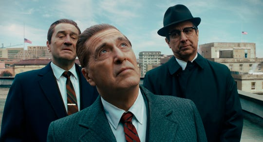 """This image released by Netflix shows, from left, Robert De Niro, Al Pacino and Ray Romano in a scene from """"The Irishman."""" On Monday, Dec. 9, 2019, Pacino was nominated for a Golden Globe for best supporting actor in a motion picture for his role in the film."""