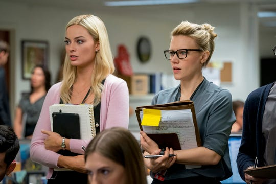 """This image released by Lionsgate shows Margot Robbie, left, and Kate McKinnon in a scene from """"Bombshell."""" On Monday, Dec. 9, 2019, Robbie was nominated for a Golden Globe for best supporting actress in a motion picture for her role in the film."""
