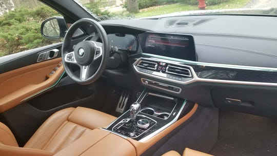 The interior of the 2020 BMW X7 50i is state-of-the-art tech, lighting and chocolate leather seats.