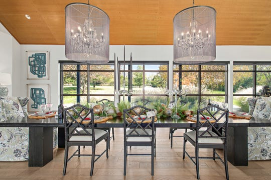 Dining room, after: In the dining area a lot of the mirrors, tables and chairs had wooden or light leather elements to enhance the reach of the natural wood ceiling.