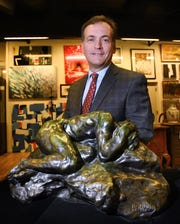 "DuMouchelles auctioneer and appraiser Robert DuMouchelle with the bronze sculpture ""Le désespéré"" by Auguste Rodin, which the auction house will put on the block this weekend."