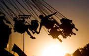In this July 23, 2009 file photo, children ride a swing ride during the Canyon County Fair in Caldwell, Idaho. New results published Monday, Dec. 9, 2019,  in JAMA Pediatrics from the largest long-term study of brain development and children's health raise provocative questions about obesity and brain function.