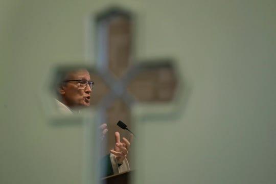 In this Sunday, Oct. 20, 2019 photo Rev. William Tourigny, pastor of St. Rose de Lima Parish, in Chicopee, Mass., offers Mass at the Catholic church.