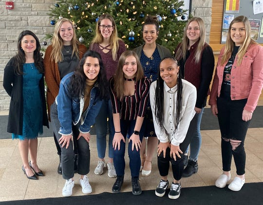 Marian University's Sabre Voice will publish only its second print edition since 2007 on Dec. 10. Pictured are, back row, from left: Assistant Professor of Communication Patricia Hernandez, Emma Lewandowski, Laney  Spradlin, Bradey Resulta and Jazmyne Thomson; front row: Gracie Thies, Robynn Leverich and Shana Risby.