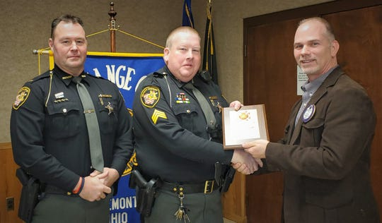 Sheriff's Sergeant Eric Arquette, center, was awarded the Fremont Exchange Club's First Responder Award