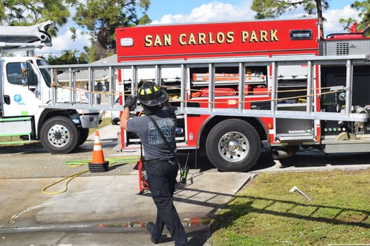 Firefighters from San Carlos Park Fire District put out a fire at a home on Love Road on Monday afternoon.