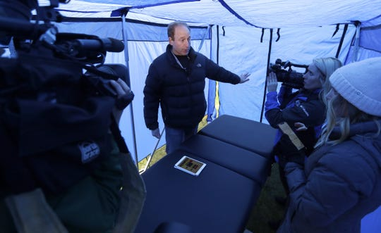 Jeff Miller, NFL executive vice president of player health and safety Innovations, talks about the uses of the pop-up medical tent used on the sidelines of Lambeau Field during a media tour on Dec. 8.