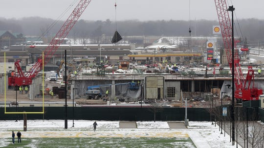The platform for a 150-unit, five-story apartment building and office building being built during the second phase of the Green Bay Packers' Titletown District construction project is pictured on Dec. 9, 2019, in Ashwaubenon, Wis.