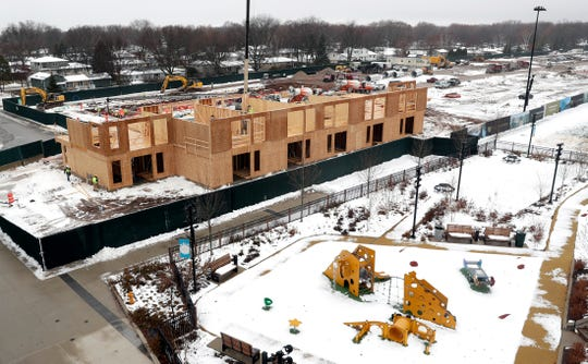 Townhouses being built along Brookwood Drive as part of the second phase of the Green Bay Packers' Titletown District construction are pictured on Dec. 9, 2019, in Ashwaubenon, Wis.
