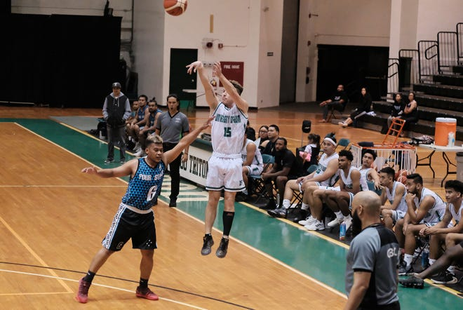 Logan Hopkins (15) added 22 points for the Tritons during their game Sunday night at the University of Guam Calvo Field House.