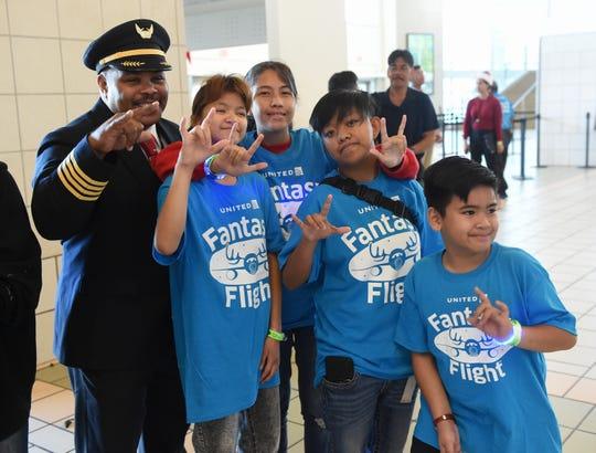 Errol Lee Jr., United Airlines captain, meets with child passengers of the United Fantasy Flight at Antonio B. Won Pat International Airport, Tamuning, Dec. 9, 2019.