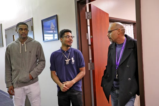 Devin Horne, from left, and Darius Cross speak with YES Career Navigator David Davis at Community Alliance of the Far Eastside (CAFE), Monday, Dec. 2, 2019.  CAFE is a multi-service community center that provides programs and services to help area residents better the quality of their lives. YES is a program that includes coaching youth between the ages of 16 and 24, connecting them with local employment opportunities, accessing trade and occupational skills training, and college.
