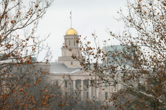 The Old Capitol Building is pictured from the west side of campus as snow falls, Monday, Dec. 9, 2019, on the University of Iowa campus in Iowa City, Iowa.