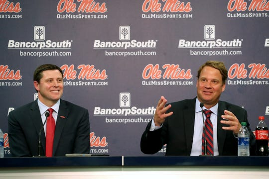 Ole Miss football coach Lane Kiffin, right, speaks during his introductory press conference on Dec. 9, 2019, in Oxford, Mississippi.