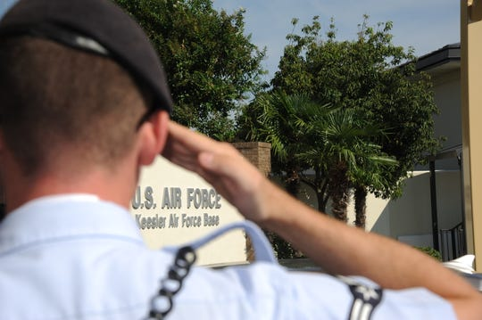 An airman with the 81st Security Forces Squadron salutes an officer as he enters one of the gates at Keesler Air Force Base, in Biloxi, Miss., in this Oct. 4, 2012, file photo.