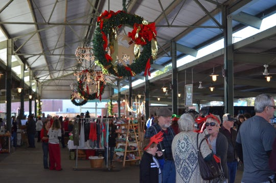 Community members chat and shop at Jackson's Christmas in the City event on Dec. 7, 2019.