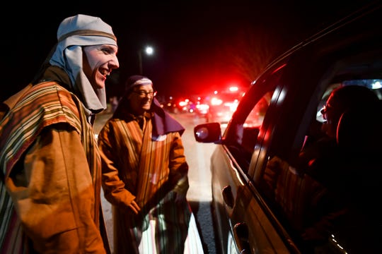 Dakota McCarter, left, and Shane Sands are acting as wise-cracking camel traders to entertain visitors while they wait to see Mountain View Church's drive-through nativity in Dandridge on Friday, December 6, 2019.