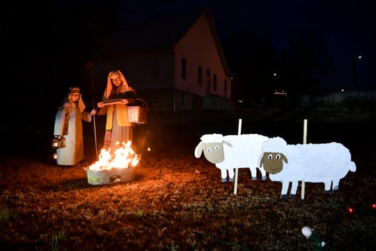 Kayla Bradley and Weston Satterfield are shepherds in Mountain View Church's drive-through nativity on Friday, December 6, 2019.