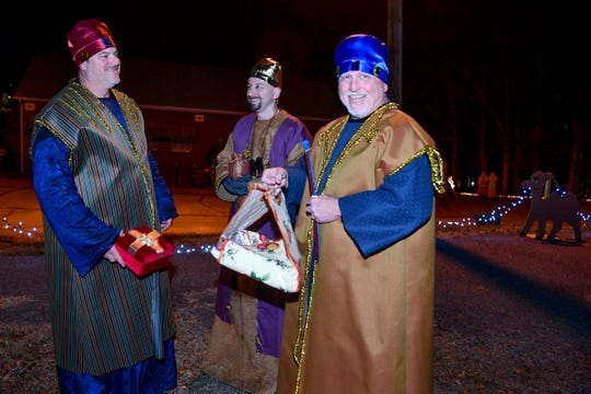 """From left, Mike Roberts, Jon Coppenger, and Michael Wallis wait for the next vehicle to entertain while dressed as the """"Three Wise Guys"""" in Mountain View Church's drive-through nativity on Friday, December 6, 2019."""
