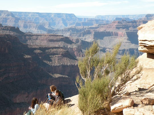 Hikers take a break to enjoy the spectacular view on the South Kaibab Trail in Grand Canyon National Park.