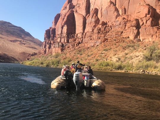 Rafts carry passengers down the Colorado River through Glen Canyon. A ride in the canyon, northeast of Grand Canyon National Park, includes a trip around iconic Horseshoe Bend.