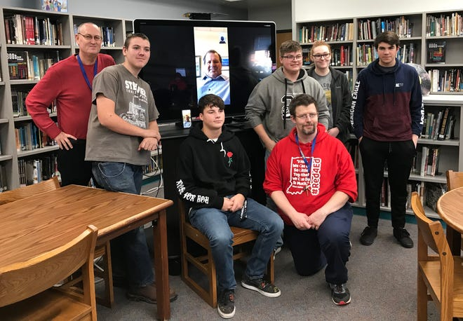 "Students and teachers from North White High School's ""Topics in the 1980s"" class pose with Mike Eruzione, after the captain of the 1980 USA hockey team did a long-range Q&A with the class from Boston. From left, teacher Todd Shriver, students Craig Hall, Richie Spear, Tean Reames, Alexi Saubert and Caleb Rutledge, along with teacher Eric Stewart (kneeling)."