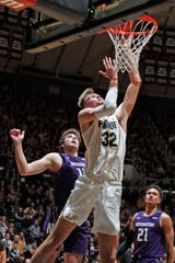 Dec 8, 2019; West Lafayette, IN, USA; Purdue Boilermakers center Matt Haarms (32) takes a shot against Northwestern Wildcats guard Pat Spencer (12) during the second half at Mackey Arena. Mandatory Credit: Brian Spurlock-USA TODAY Sports