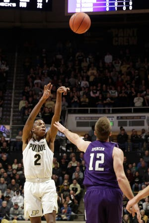 Purdue guard Eric Hunter Jr. (2) goes up for three over Northwestern guard Pat Spencer (12) during the first half of a NCAA men's basketball game, Sunday, Dec. 8, 2019 at Mackey Arena in West Lafayette.