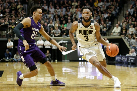Purdue guard Jahaad Proctor (3) dribbles against Northwestern forward A.J. Turner (21) during the second half of a NCAA men's basketball game, Sunday, Dec. 8, 2019 at Mackey Arena in West Lafayette.