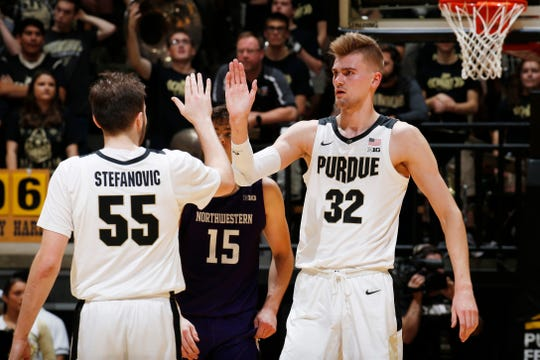 Dec 8, 2019; West Lafayette, IN, USA; Purdue Boilermakers center Matt Haarms (32) celebrates with guard Sasha Stefanovic (55) against the Northwestern Wildcats during the first half at Mackey Arena. Mandatory Credit: Brian Spurlock-USA TODAY Sports
