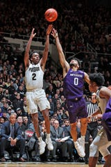 Dec 8, 2019; West Lafayette, IN, USA; Purdue Boilermakers guard Eric Hunter Jr. (2) takes a shot against Northwestern Wildcats guard Boo Buie (0) during the second half at Mackey Arena. Mandatory Credit: Brian Spurlock-USA TODAY Sports