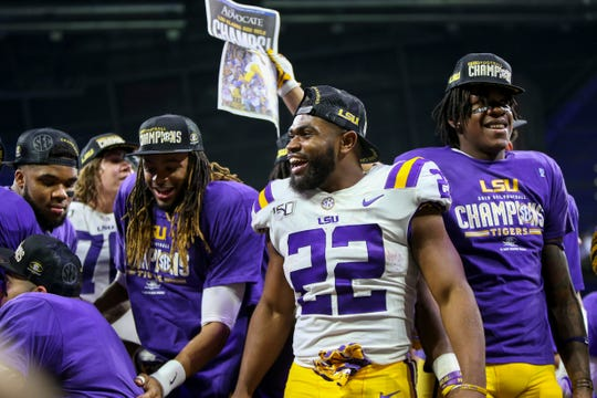 Dec 7, 2019; Atlanta, GA, USA; LSU Tigers running back Clyde Edwards-Helaire (22) celebrates after a victory against the Georgia Bulldogs in the 2019 SEC Championship Game at Mercedes-Benz Stadium. Mandatory Credit: Brett Davis-USA TODAY Sports