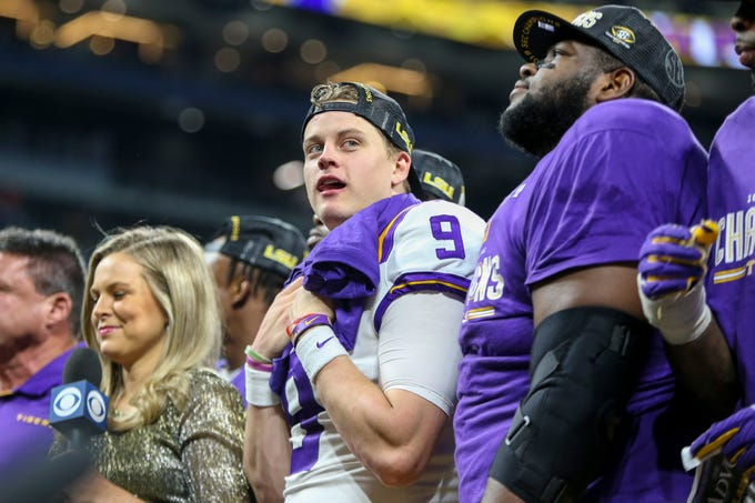 Dec 7, 2019; Atlanta, GA, USA; LSU Tigers quarterback Joe Burrow (9) celebrates a victory against the Georgia Bulldogs in the 2019 SEC Championship Game at Mercedes-Benz Stadium. Mandatory Credit: Brett Davis-USA TODAY Sports